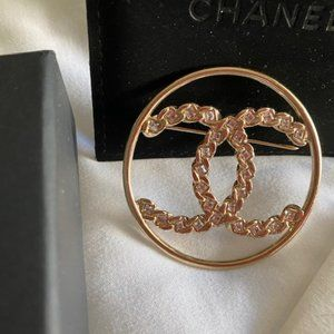 Authentic Chanel CC Round Brooch with diamonds